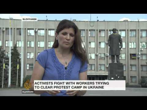 Protests erupt in Ukraine as clashes continue in east