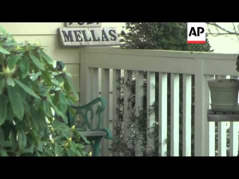 Family of Amanda Knox leave house with person obscured with a jacket