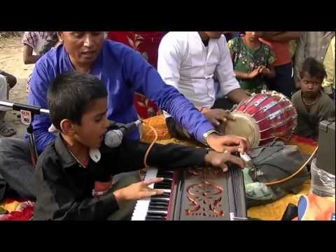 Child Singing Christian Bhajan And Playing Harmonium In Indian Village video