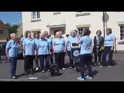 Noteify performing Drift Away as part of the filming of Street Auction