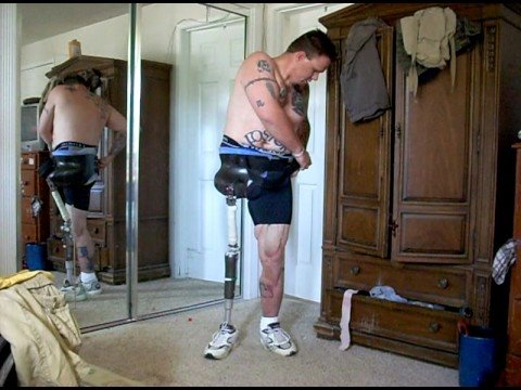 Prosthstic Leg Amputee in underwear getting dressed Video