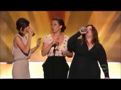 Maya Rudolph, Kristen Wiig & Melissa McCarthy present Bridesmaids as Best Film at the 2012 SAG awards. While doing so they also let us in on a drinking game they played on the set of Bridesmaids...