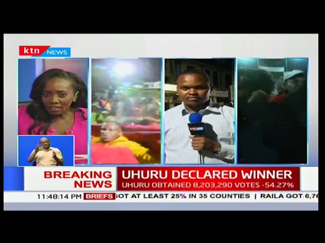 Nyeri residents react after Uhuru Kenyatta was declared president-elect in Kenya's 2017 poll