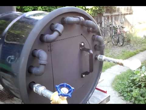 Wood fire hot water heater youtube for Garden pool with heater