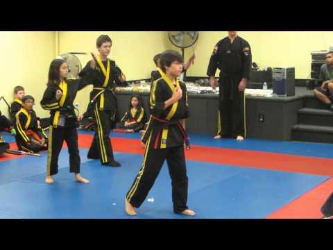 Kai leading a demo at karate graduation