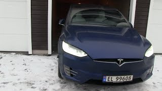 Model X summoning in and out of tight garage