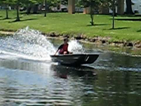 Me going full speed on a 14 ft. JON BOAT, with 8 HP ...