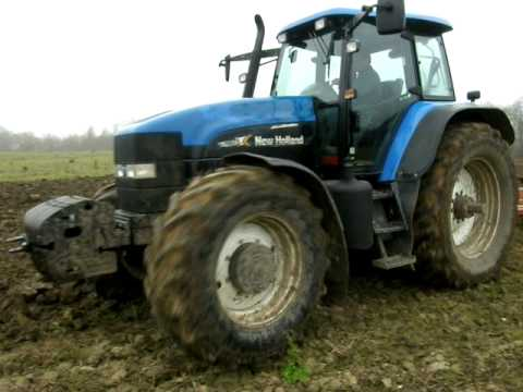 New Holland TM175 ploughing
