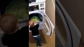 Baby JC doing laundry