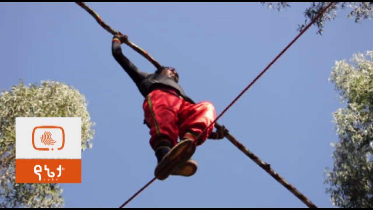 Ethiopian man walking on rope