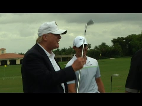Donald Trump returns the 3-iron to Rory McIlroy at Cadillac Championship