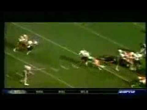 Georgia's Herschel Walker runs over Tennessee's Bill Bates