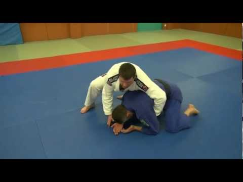 BJJ - Turtle position attack - Crucifix choke Image 1