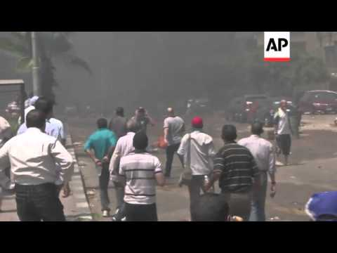Clashes between security forces and Muslim brotherhood continue in Cairo and Suez