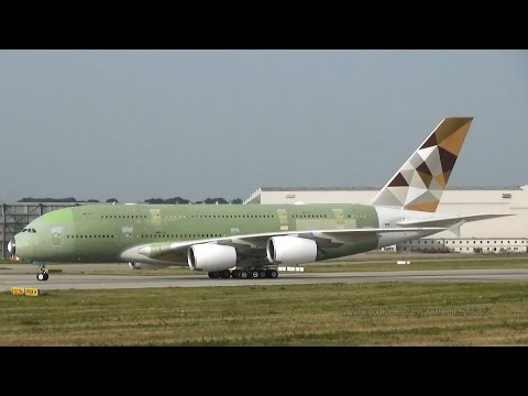First Etihad Airways A380 A6-APB in primer with painted tail landing at Hamburg Finkenwerder