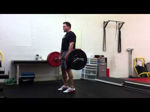 Olympic Weightlifting: Squat Clean Technique from the hang position above the knee Image 1
