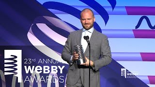 Adam Richman presents to Webby Winner Sean Evans of Hot Ones