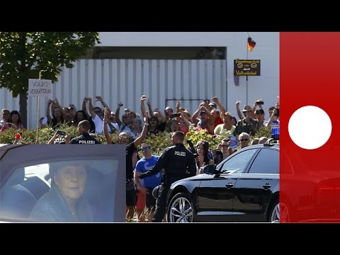 Merkel booed and heckled on arrival at refugee shelter, Germany