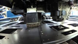 Mechanical and laser sheet metal fabrication on one metal part