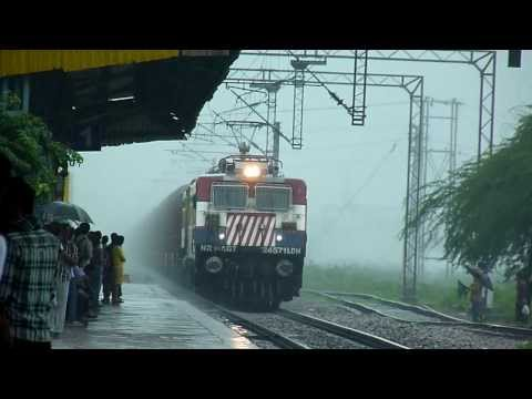 Train disappears into heavy rains!!