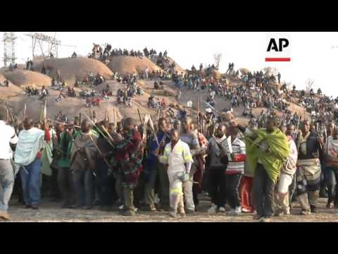 Workers at platinum mine continue to protest over pay as unrest grips industry