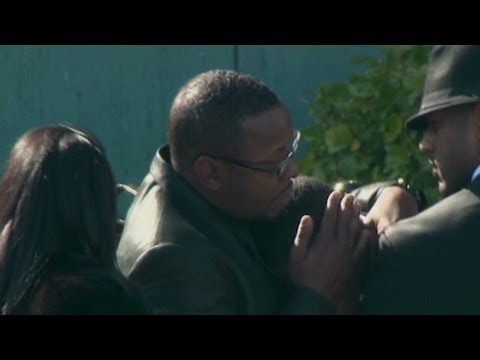 Whitney Houston Funeral - Bobby Brown comforts friend at funeral