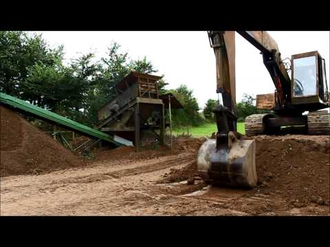 Screening top soil with my old excavator