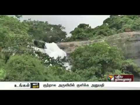 Tourists allowed to have a bath a Courtallam following reduction in flow of water