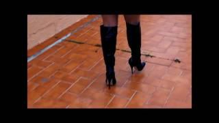 walking in high heel knee boots
