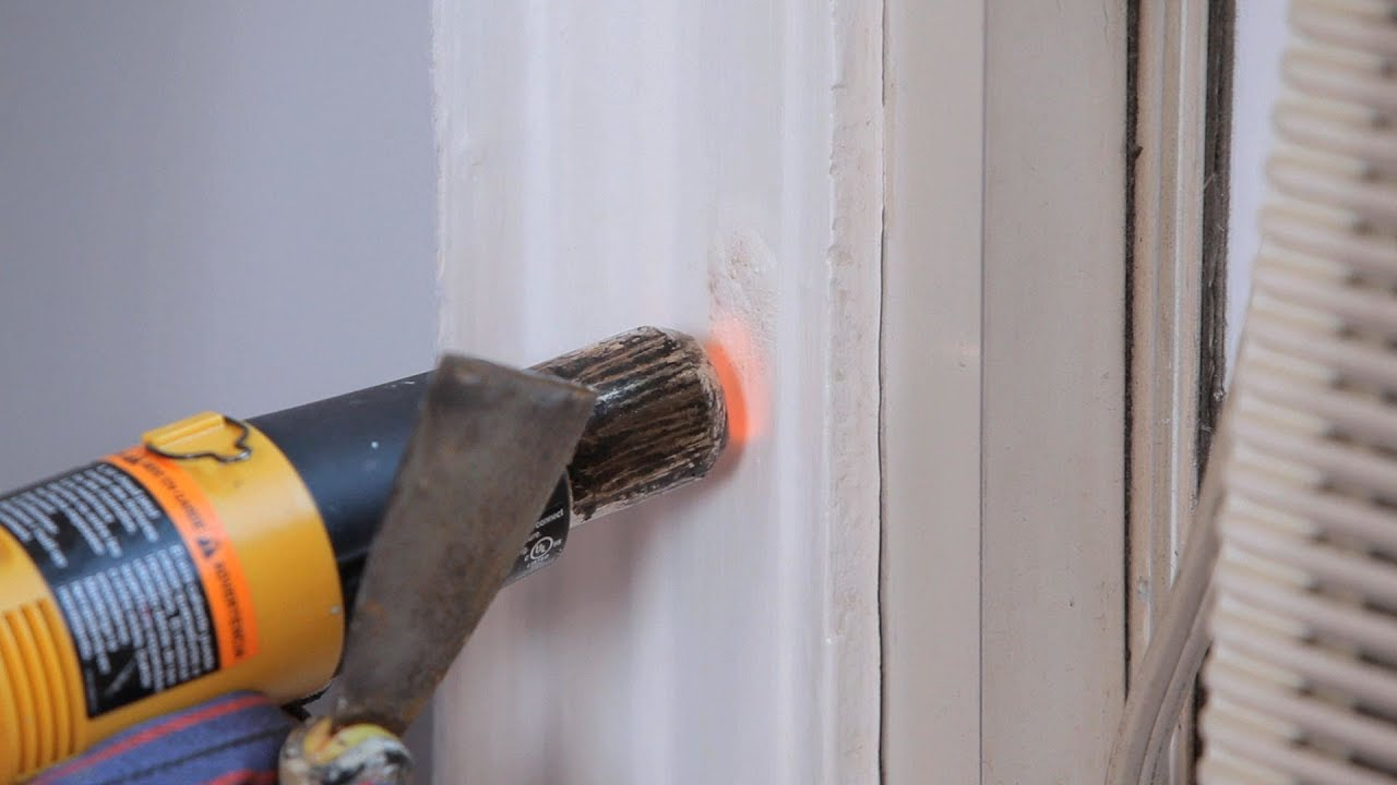 stripping wallpaper with a steamer