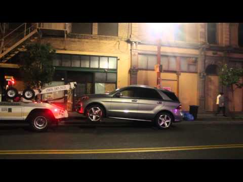 tow truck driver threatens to kill Mike blue hair