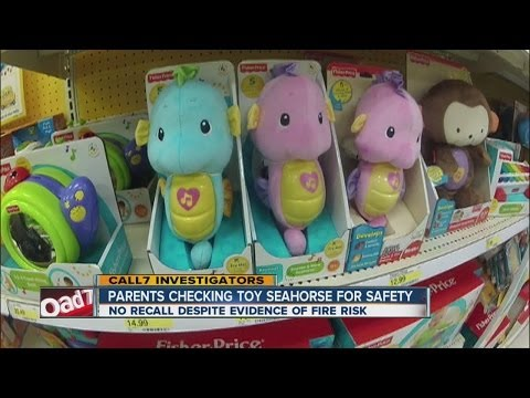 Parents checking toy seahorse for safety