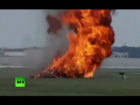 Dramatic video: Bi-plane crashes & explodes in flames at air show in Ohio