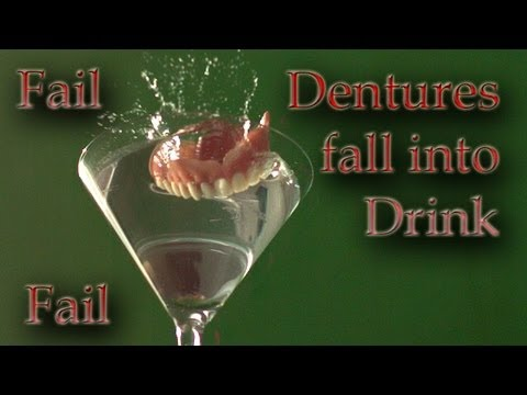 Teeth fall into drink in slow motion