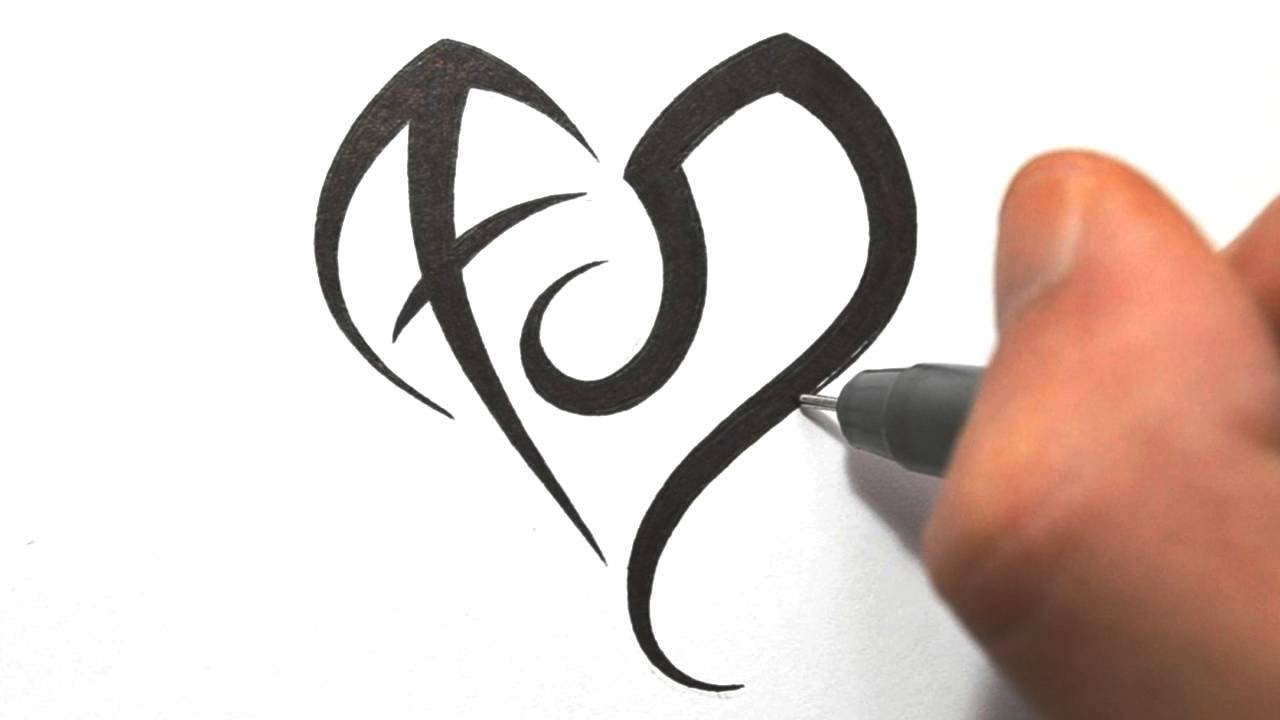 Designing Zodiac Symbols Sagittarius And Leo In A Heart Shape