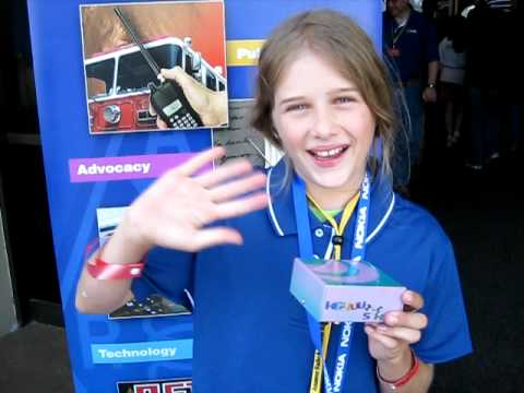 Yuki Klotz-Burwell, K6YUU (daughter of Leigh Klotz WA5ZNU) shows-off a radio kit project she completed: a 40-meter CW transceiver (DC40A distributed by Hendr...