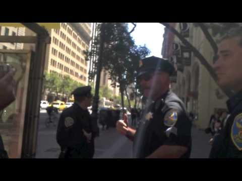 HE MAKES ARMED COPS LEAVE HIS SPACE -  SAN FRANCISCO - JULY, 2012