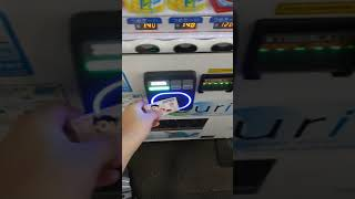 Buying tea from a vending machine