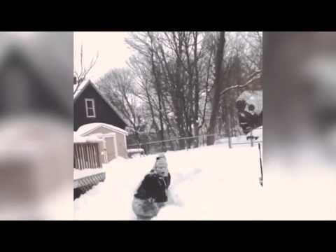 People in Boston jumping out of windows into snow