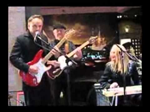 Jimmie Vaughan and Redd Volkaert playing together at the Bob Bullock Museum