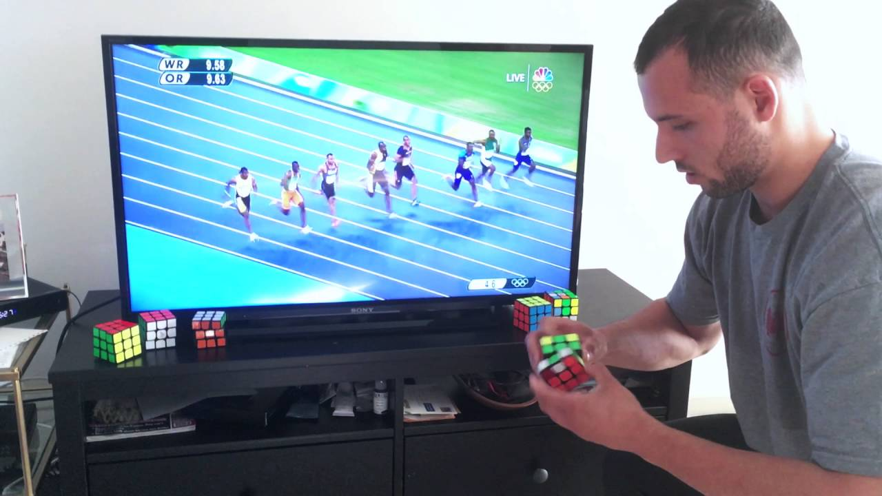 [Usain Bolt Finishes Second To Rubik's Cube Guy] Video