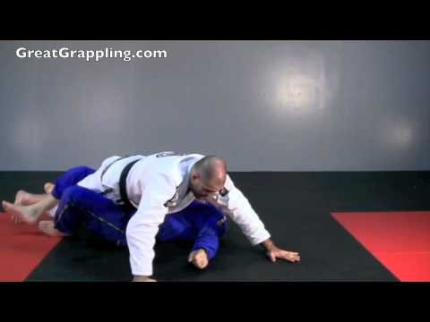 Half Guard Submission Straight Armbar Image 1