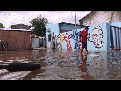 After pope visit, no miracles in flooded Paraguay shantytown
