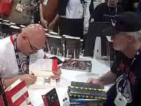 Greg Rucka signing copies of Patriot Acts at ComicCon