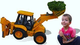 Darius PRETND PLAY with TRACTOR EXCAVATOR helping Daddy to gather the grass