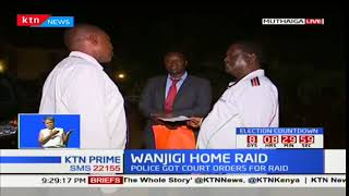 NASA leader Raila Odinga serves police personnel at Jimi Wanjigi's Muthaiga home with a court order