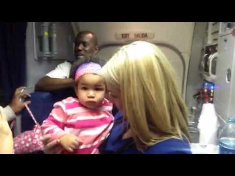 United Airlines Flight Attendant And Cute Baby On B737-200