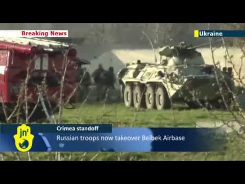 Putin's Invasion of Crimea: Russia uses armored vehicles to break into Ukrainian army base