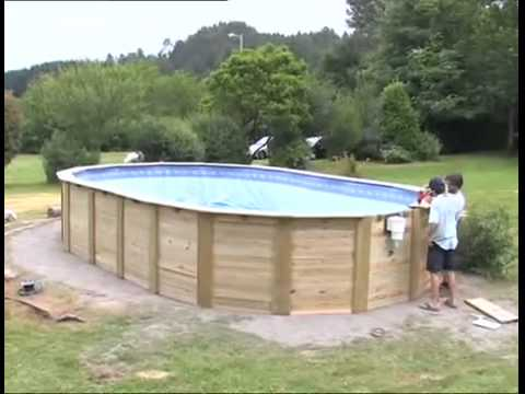 Instalaci n de una piscina de madera gre ovalada www - Piscinas desmontables de madera ...