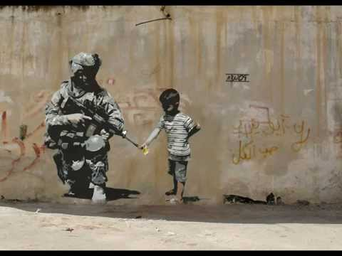 New Street art by Banksy . Famous graffiti wall art by british artist Banksy